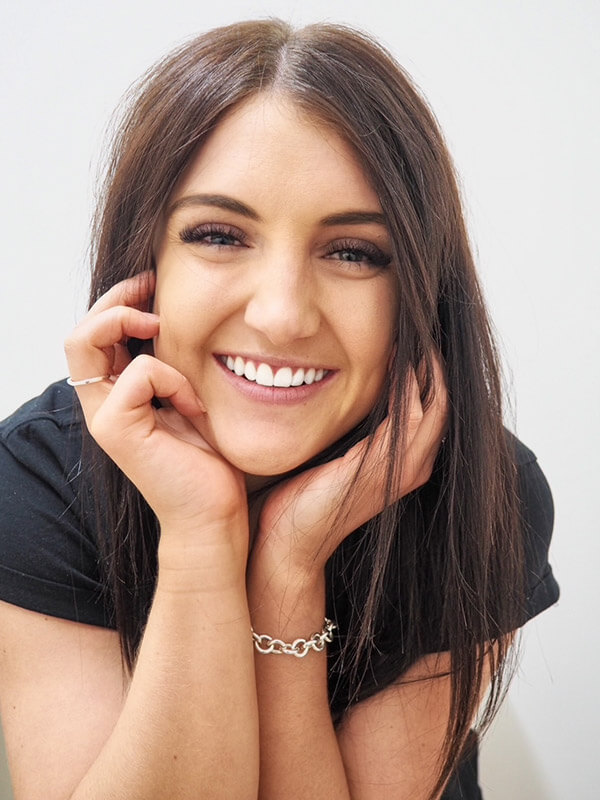 Girl smiling after whitening treatment
