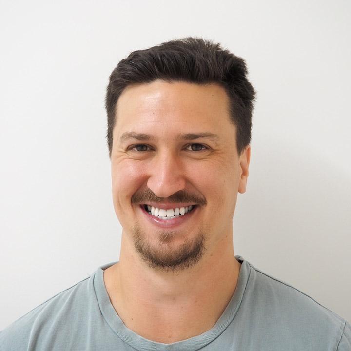 Man with beard smiling to show teeth